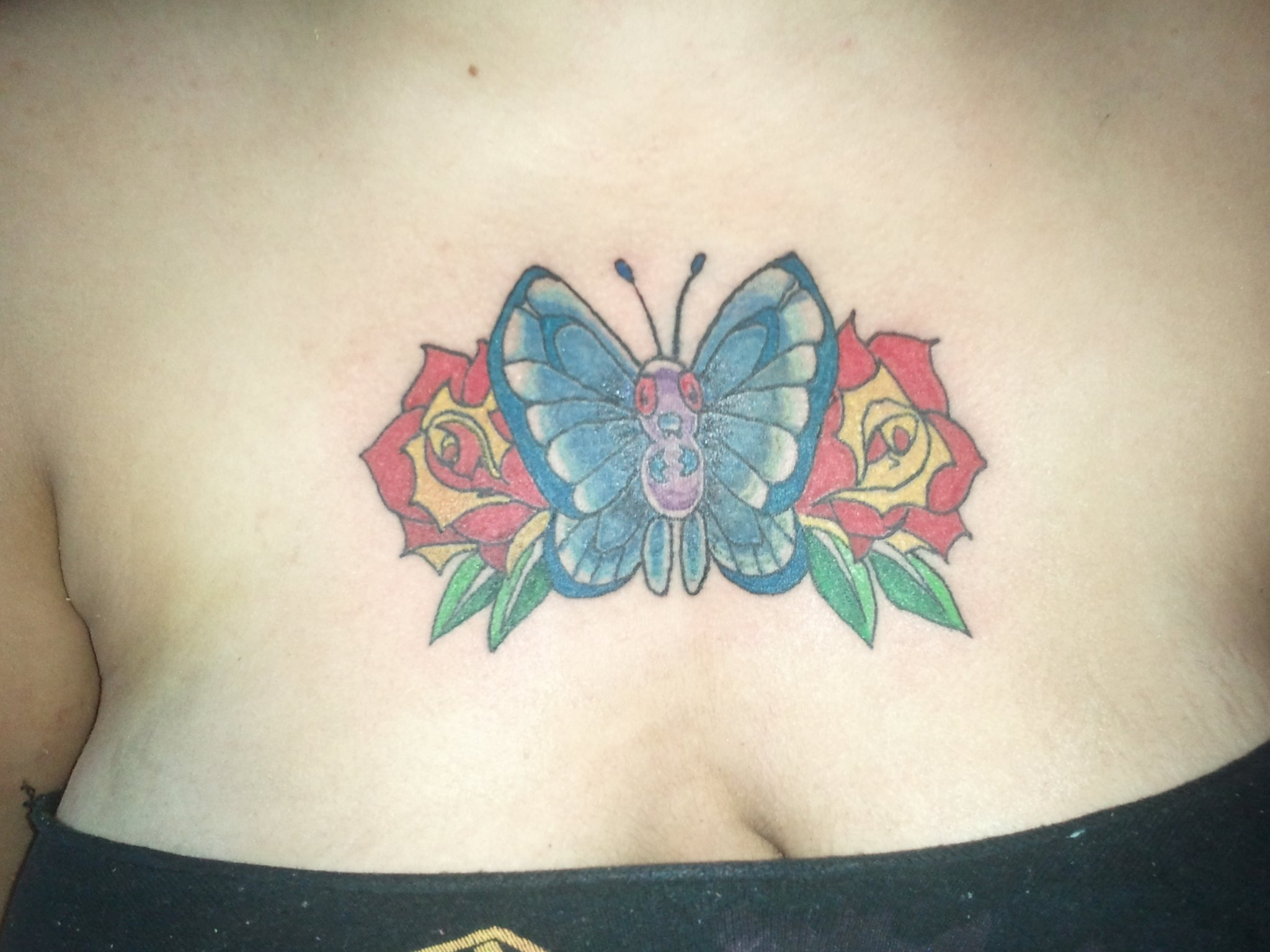 Beautiful Butterfly chest piece on my lil' Seester!